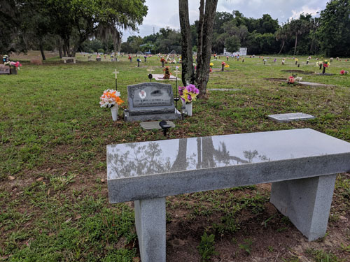 bench and headstone